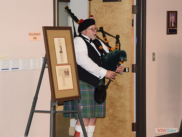 The bagpipe calls the event to order